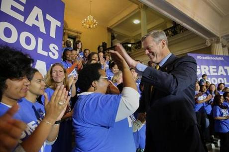 Baker greeted charter school members. Tough rivals who oppose such schools are against him.